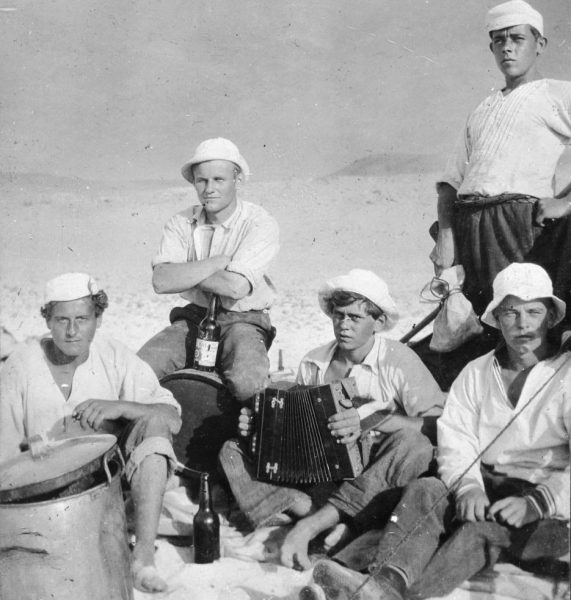 Young sailors with accordion in old-time photo