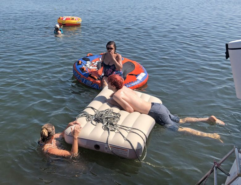air mattress and floaty toys
