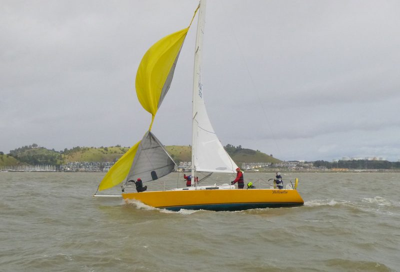 Yellow Fin with spinnaker wrapped around jib.