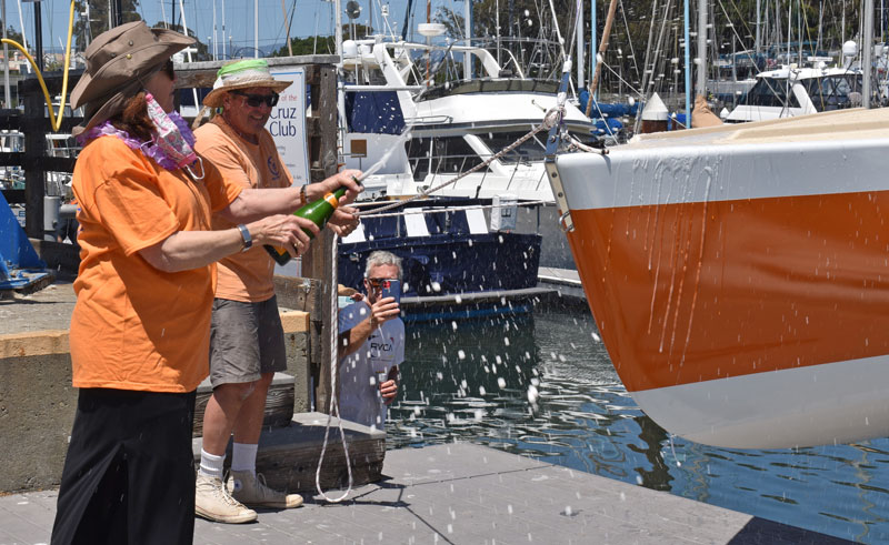 Christening the bow with champagne.