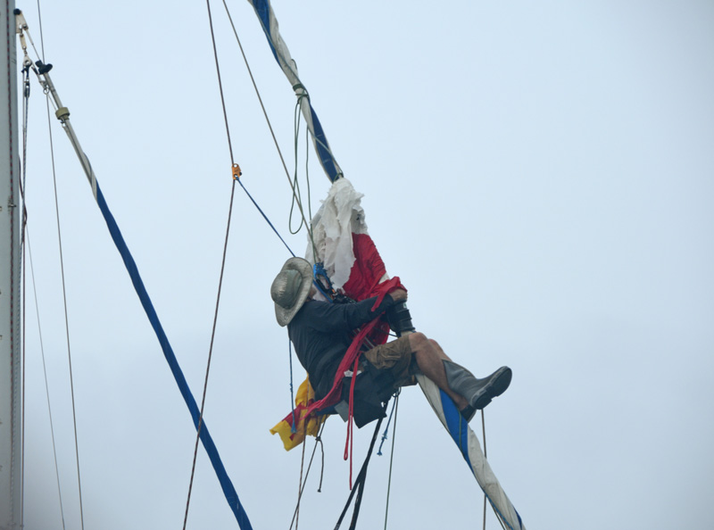 sailor up the rig hanging onto headstay.