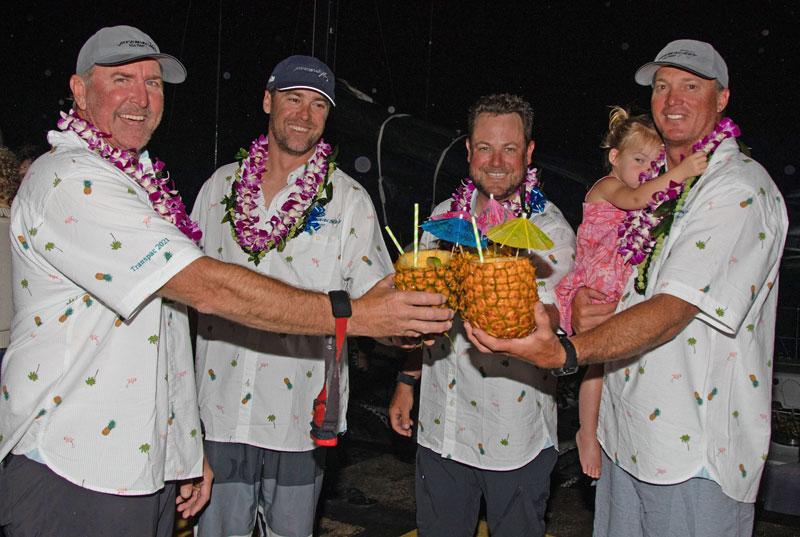 Pyewacket crew with pineapple drinks.