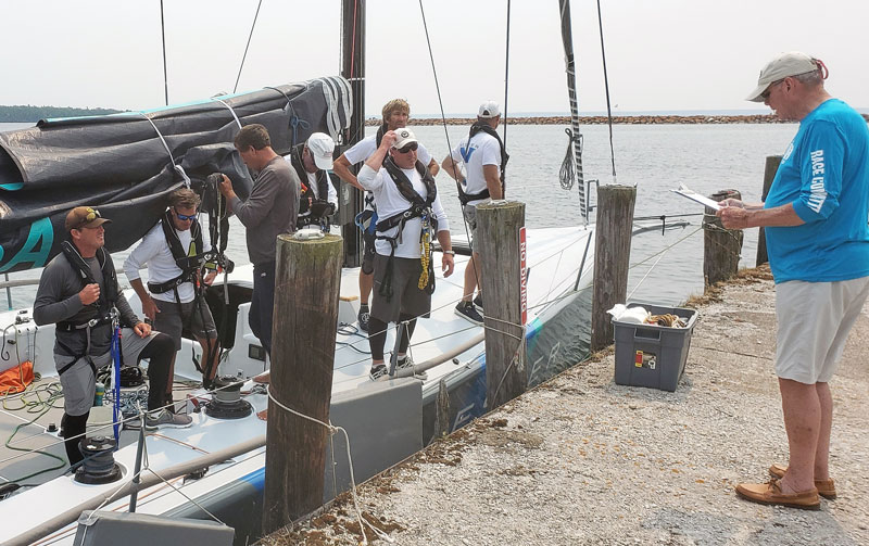 Vesper crew with race committee official