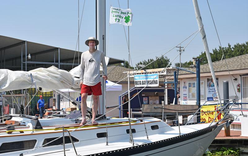 Dan Throop on the Islander 36 Windcatcher at the dock.