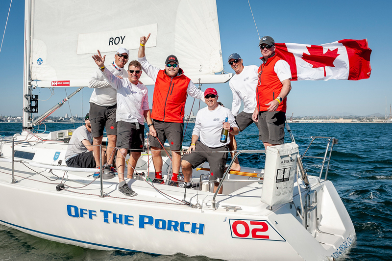 Andy Roy and crew with Canadian flag