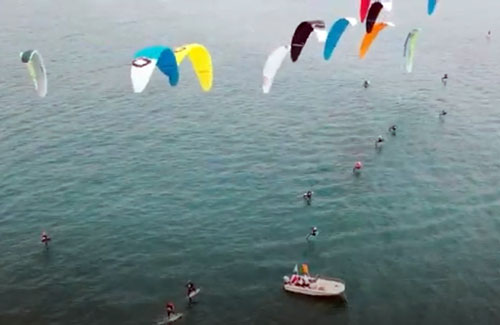 aerial of foiling kiteboarders
